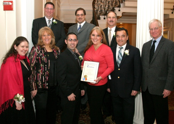 The Glen Cove EMS recently held its annual installation of officers. Nassau County Legislator Delia DeRiggi-Whitton is pictured honoring Matthew Venturino alongside Georgina Dambrini, Deputy Mayor Maureen Basdavanos, Judge Richard McCord, Jim Jones, Robert Gobbo, City Councilman Anthony Jimenez, Judge Joseph McCann.