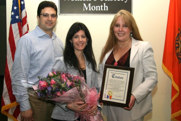 Laura Perfetti (center) with husband Anthony, named Trailblazer of the Year by Nassau County Legislator Delia DeRiggi-Whitton, 18th LD.